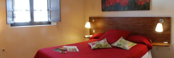 estancia familiar con habitación y terraza, vista habitación